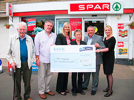 Flashback to August last year as Spar Ladybank receives its prize as winner of the Kingsmill Community Grant. Left to right: Bill Watters and David Croll of the Ladybank Development Trust; Jill McEwan, area manager, Spar; Chrissie McLaren, Spar Ladybank; and Robert Wilson and Dionne Wilson, Kingsmill.