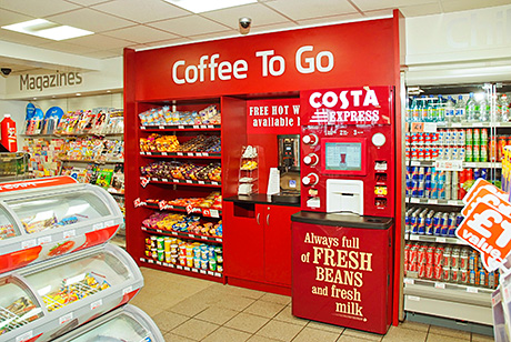 The left hand wall includes a specially designed and built coffee to go section and a bank of four remote-compressor, double-doored chillers