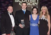 Wendy Morrell, second right, and her husband Malcolm, second left, receive the 2013 Merchandising Award, run in association with P&G, at the 2013 Scottish Grocer Awards presentation event.