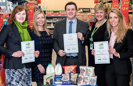Some of the latest participants in the Scotland Food and Drink and Asda project, the Supplier Development Academy, celebrating their achievements. Launched in January 2013, the programme has supported 35 suppliers and trained almost 100 employees in consultations, workshops and business mentoring and enabled Scottish suppliers to develop new product lines and deliver marketing campaigns that have resulted in additional sales worth £12.1m. Left to right: Olivia Slater, Graham's accounts controller; Stephanie Pritchard, Scotland Food & Drink access to markets manager; Craig Stewart, Mackie's retail development executive Lisa Prudhoe, Asda customer planner; Serena Durante, Porrelli sales manager.