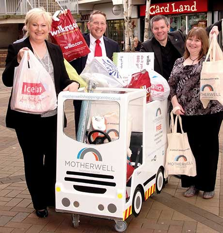 Planning minister Derek Mackay, third from left, launches Motherwell Shopping Centre's Carry to Car service.