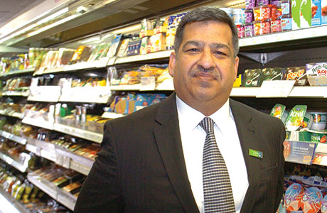 Abdul Majid, President of the Scottish Grocers' Federation, hopes to have a cross-party working group in the Scottish Parliament focused on convenience stores by the end of 2015.  He is pictured in his Nisa store in Bellshill.