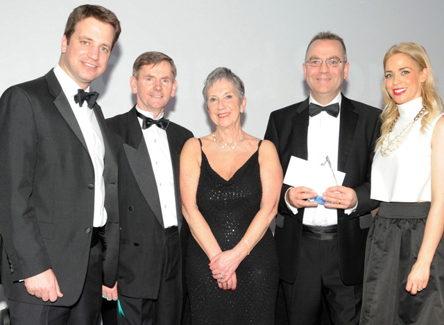 The team from CJ Lang on stage to receive the first of a total of three Achievers awards, Best Delivered Operation – Retail, sponsored by Imperial Tobacco UK.