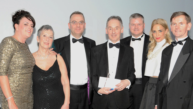 Bill Mair, sales director CJ Lang & Son, centre, and colleagues receive the Champion of Champions Award at the Scottish Wholesale Achievers presentation. The award is sponsored by Philip Morris. Also pictured are Scottish Wholesale Association executive director Kate Salmon, second left, and the event presenter Cat Cubie, second right.