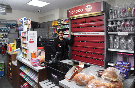 Pictured is Sandeep and Mandeep's mother, Kuldip Kaur, after whom KK Stores is named. Below, different angles on the main shop floor show the huge difference new flooring, lighting and shelving can make.