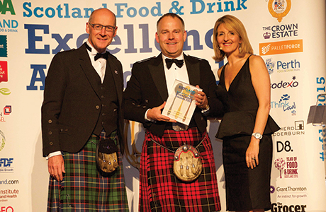 James MacSween, centre, is presented with his and his sister Jo's award for Outstanding Contribution to Food & Drink.