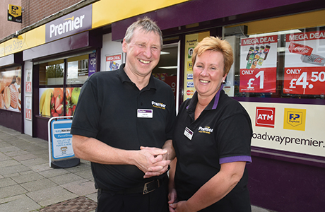 Dennis and Linda Williams outside their Premier store in Oxgangs