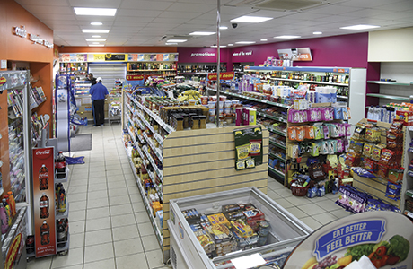 Pictures of the store's interior from before the alterations  (above) and after (below) the refit show the effects of the changes made by One Stop.