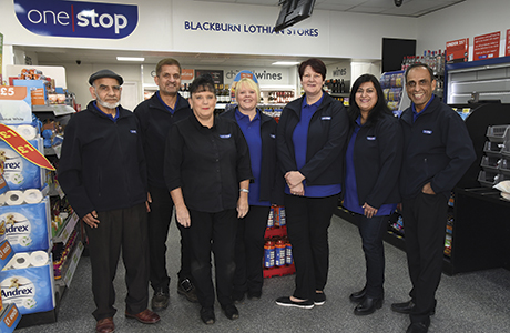 Javid and his wife Shaista (far right) look forward to the new experience of running a One Stop franchise store with the help of their staff.