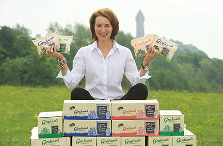 Carol Graham shows off the full range of cheddar cheese available from Graham's Dairy, including Mild, Mature and Extra Mature.