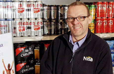 Terry Feeney in the beer cave of his large Nisa store in Linwood, near Paisley in Renfrewshire.