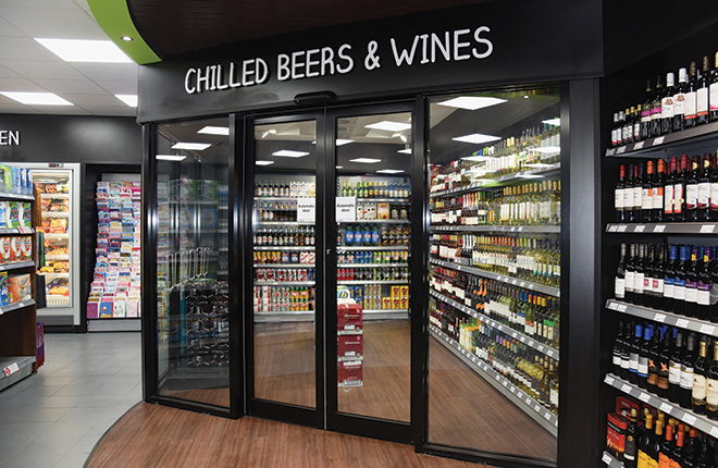 The glass-fronted chilled beer cave, around 80 sq ft in size, stands across from the counter, a bespoke design from Direct Shelving Services Ltd, including a food-to-go area.
