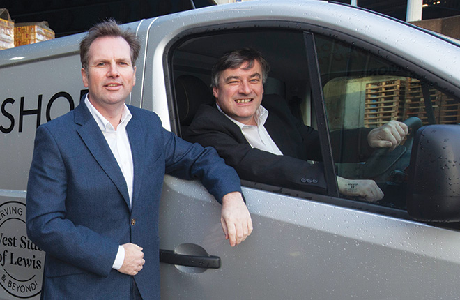 Alastair Campbell, MD, Tennent Caledonian, with Shawbost Shop owner Michael Fitzpatrick.