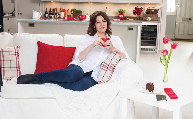 EMBARGOED 0.01 14 JANUARY: Nigella re-enacts her perfect tea moment, on set of the latest ad from Typhoo. The brand new #Typhoomoments TV advert, premieres tomorrow at 6.55am on ITV's Good Morning Britain.  Typhoo Tea Ad with Nigella Lawson  (Photo by Dave J Hogan)