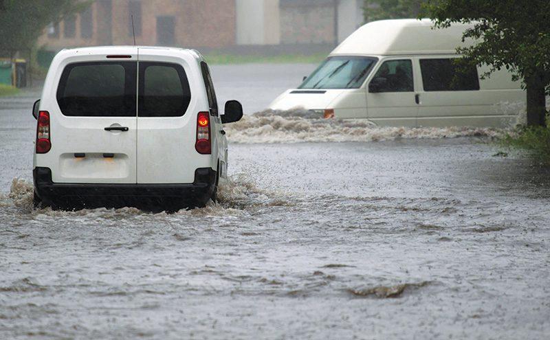 sh vans in flooded street
