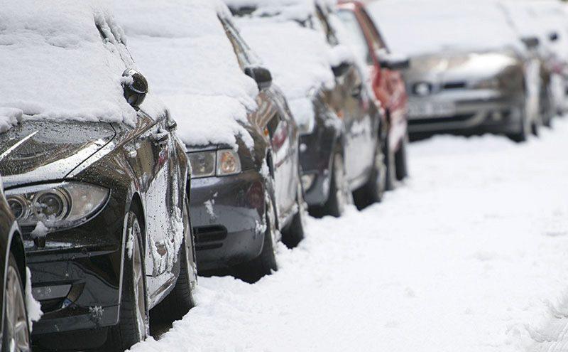 sh weather urban snow scene snow on parked cars dl Jan 15 tight crop