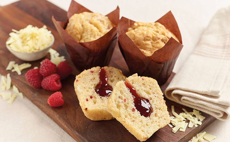 Gluten-free White Chocolate & Raspberry muffins are part of a new range from gourmet dessert producers Flower & White