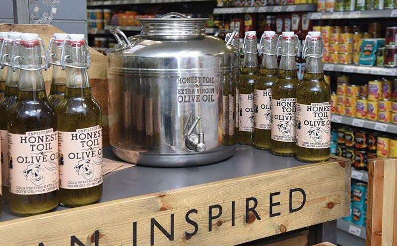 Refillable bottles of Honest Toil olive oil