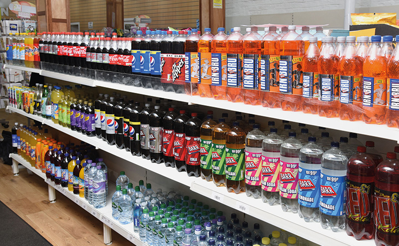 The store's central aisles are stocked with ambient soft drinks, groceries, snacks, confectionery and fresh produce.