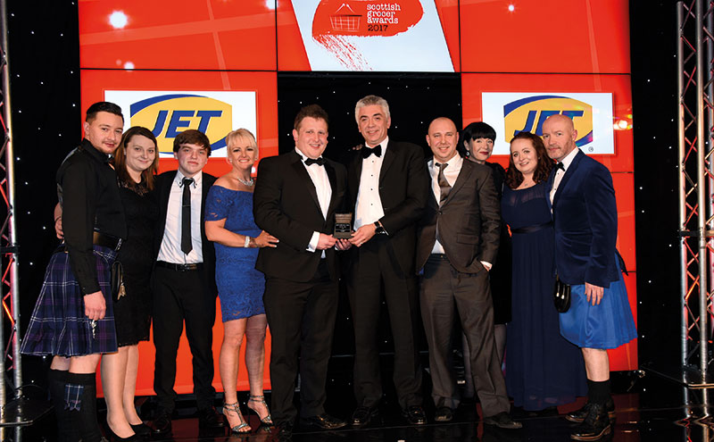 Graham Clout, retail sales manager, JET, presents the Innovation Award to Dan Brown and the team from Giacopazzi's, Sands House, Kinross. The store also scooped the Bakery Retailer of the Year award on the night.