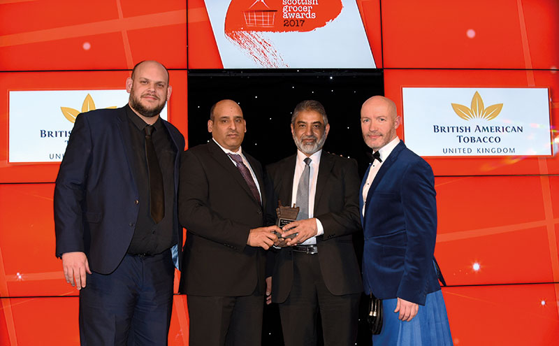 Adam Cann, regional manager north, British American Tobacco UK, left, and awards host Craig Hill, right, present the Tobacco Retailer of the Year Award to Israr Ahmed and Mohammed Sarwar, Pricekracker Dundee.