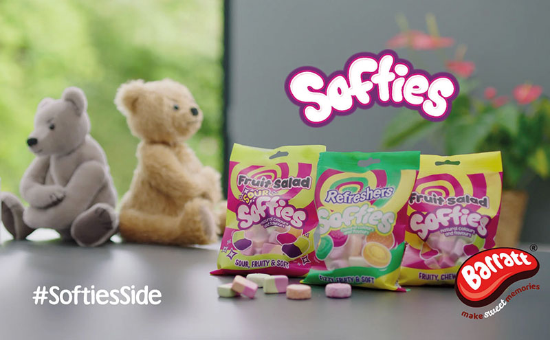 Still from Softies TV advert with sweets and two bears