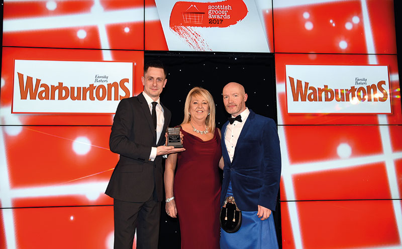 Angie Turnbull, Warburtons retail development area manager, centre, and host Craig Hill, right, present the Scottish Grocer Bakery Retailer of the Year Award (managed store) to Craig McAulay of Scotmid Stockbridge.