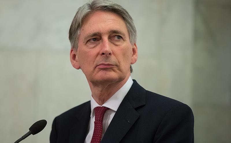 UK's sluggish economy to grow a bit more quickly: Hammond