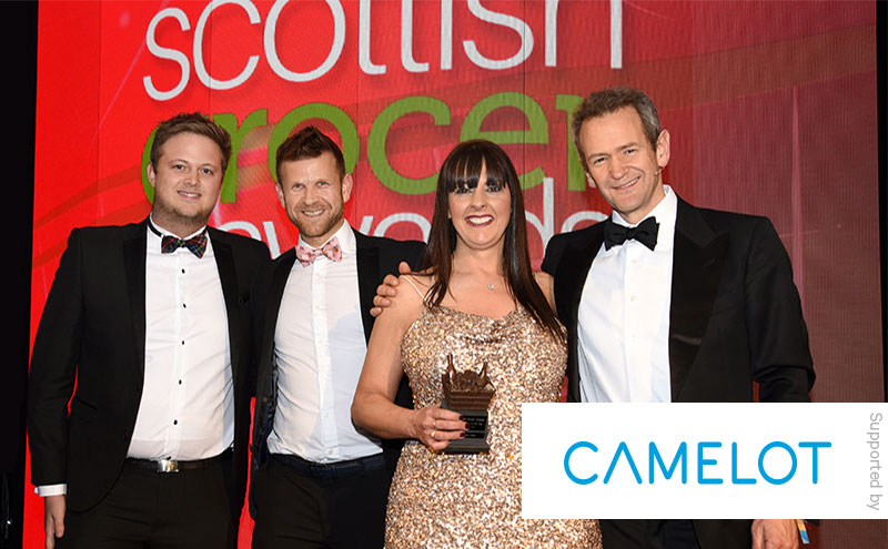 Alexander Armstrong and James Dunbar, Camelot, present the Community Retailer of the Year award to Ross Macpherson and Mandi Duncan, Barassie Day-Today, Troon.