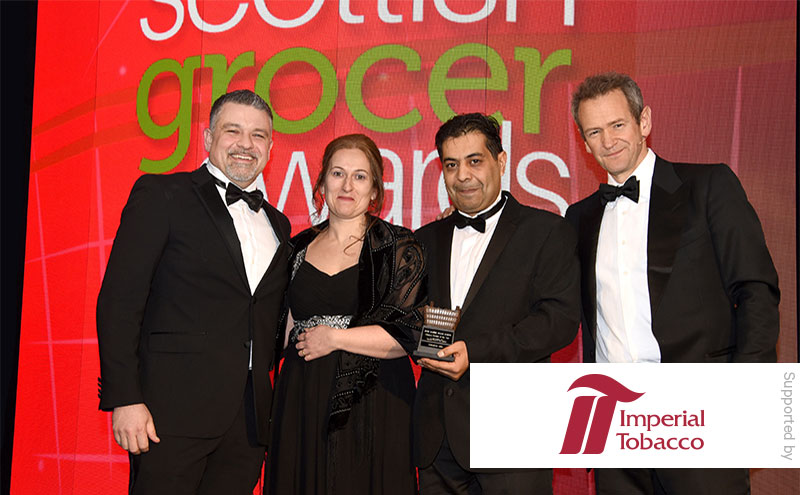 Daniel Harwood, area business manager Imperial Tobacco UK, and Alexander Armstrong present the Tobacco Retailer of the Year award to Tanveer and Lesley Baber, Shawlands News.