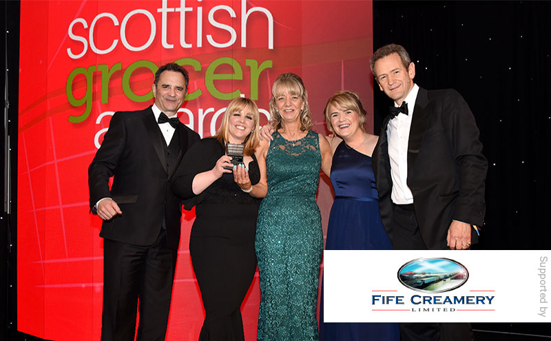 Steve Appolinari, sales director, Fife Creamery and Alexander Armstrong present the Food to Go Award to Fiona McFadyen and Elizabeth Peden, Scotmid Ratho.