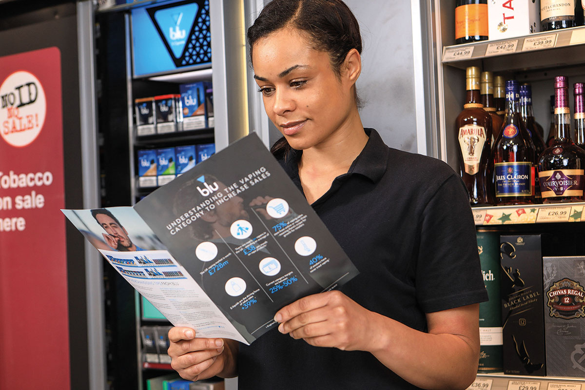 Staff member reading training booklet
