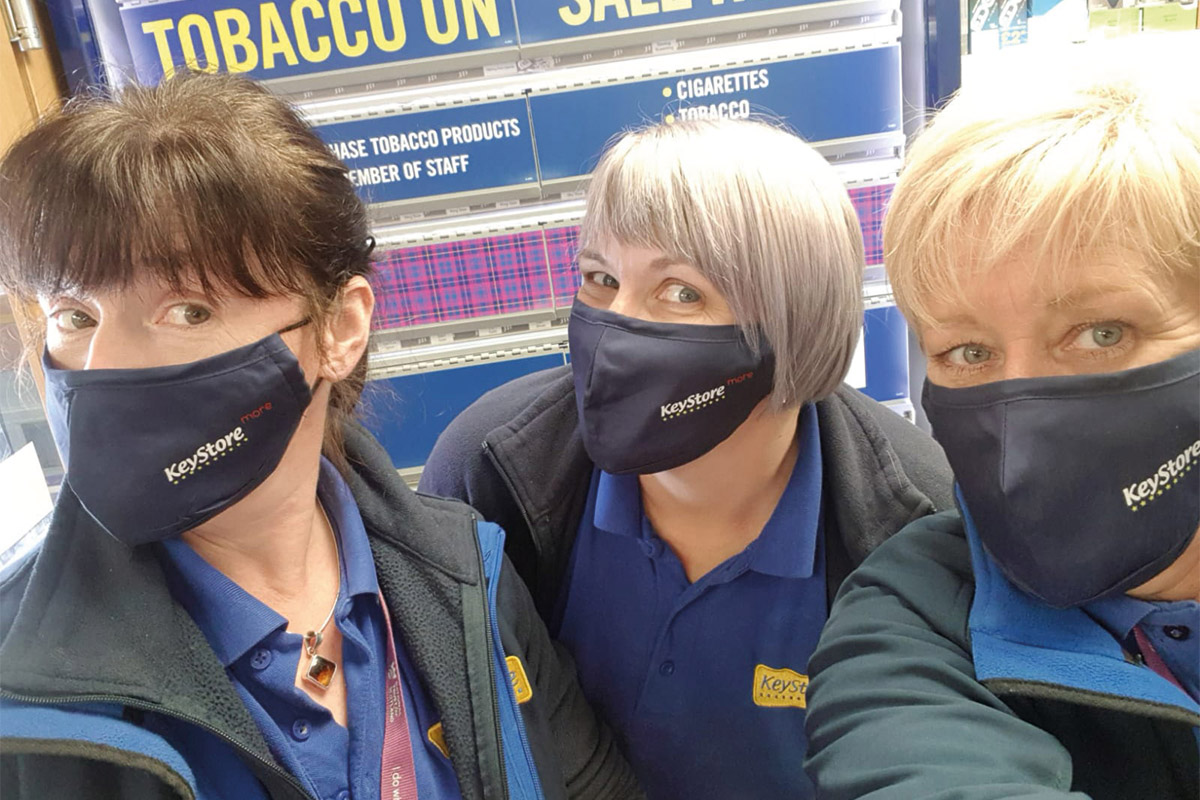 Keystore workers with branded face masks