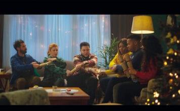 Group sitting on sofa